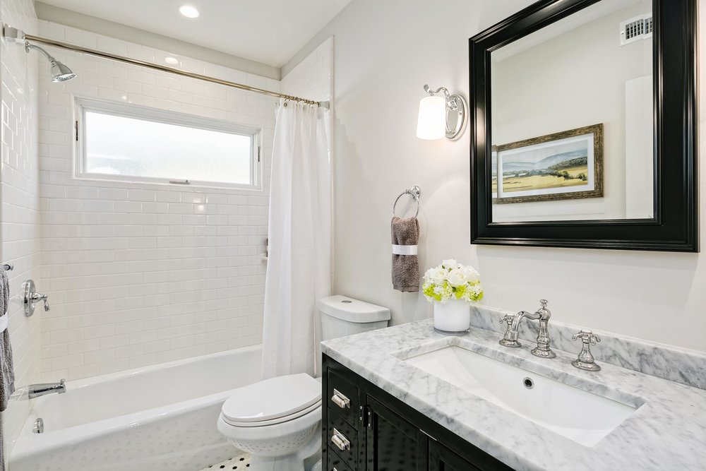 Guest-Bathroom-White-Subway-Tile-Premier-General-Contractors.jpg