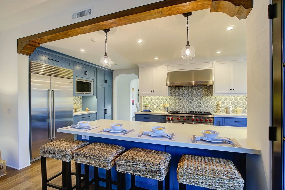 spanish-style-kitchen-blue-cabinets-premier-general-contractors.jpg