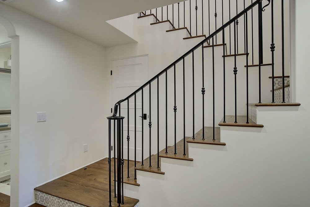 modern-spanish-staricase-wrought-iron-railing-premier-general-contractors.jpg
