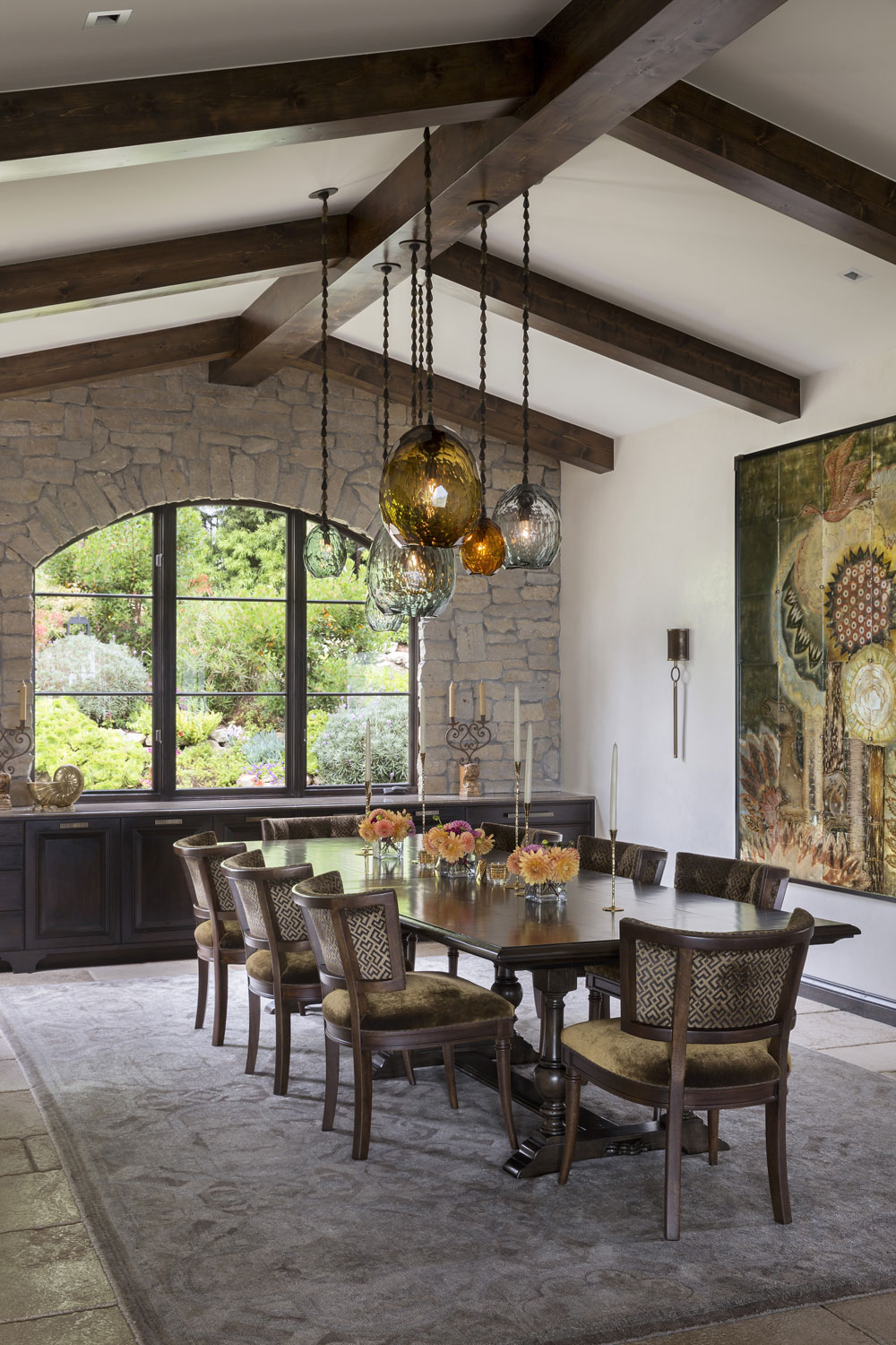contemporary-mediterranean-dining-room-beamed-ceiling-stone-wall-premier.jpg
