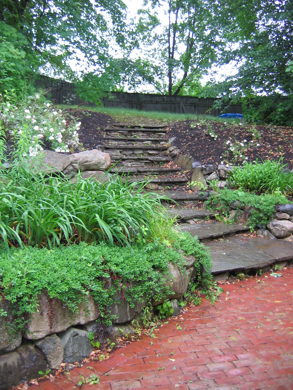 Irregular Bluestone Treads set on Field Stone Risers.JPG