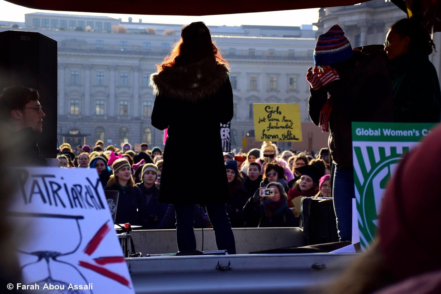 Our founder, Whitney Buchanan, at the Women's March in Berlin speaking about fostering Christian-Muslim relations and supporting refugee women.