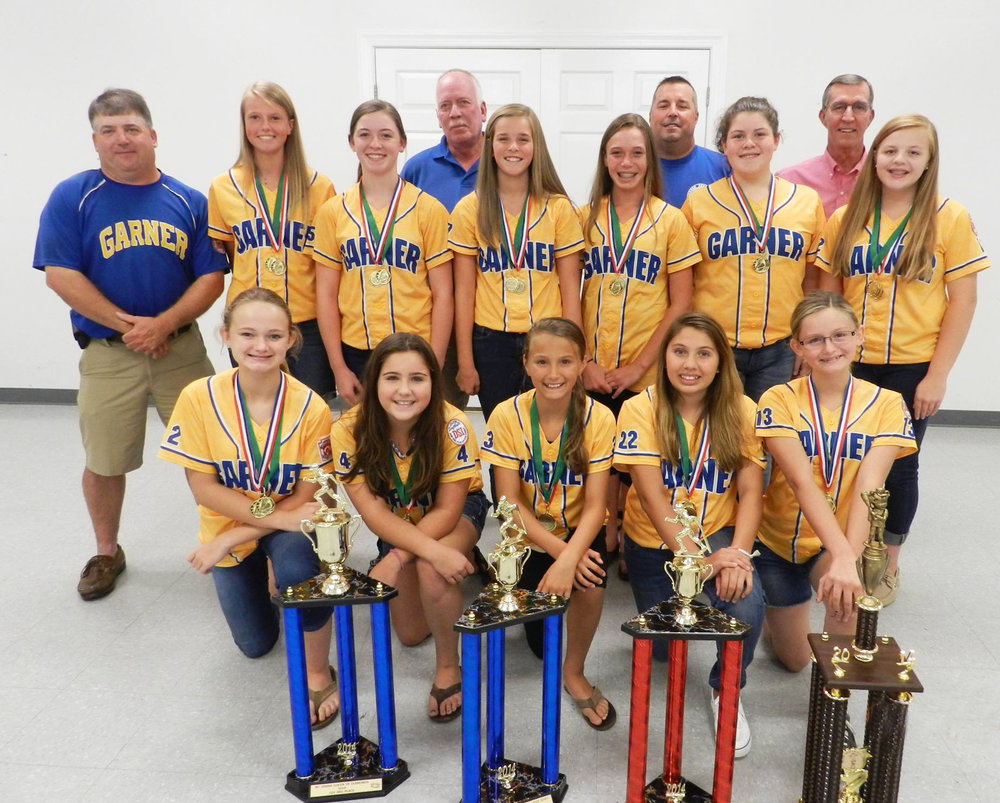 Garner Girls 12U All Stars, and Coaches attending a dinner hosted by the Garner Optimist Club, who helped sponsor them. They finished first in their District Tournament. They placed in the Regional, and won the Sportsmanship Award in their State Tournament.