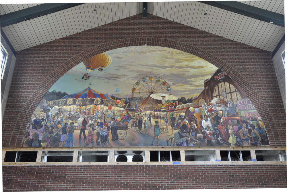 These murals grace the ends of a newly constructed 25,000 building.