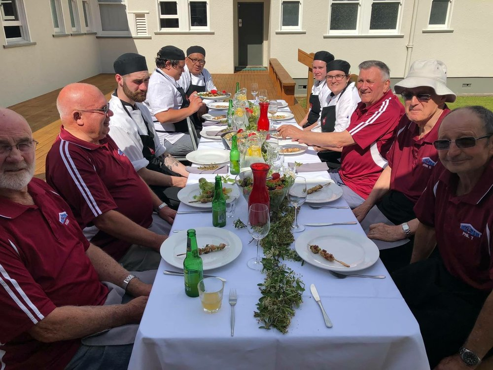 Menz Shed members and HLC Cookery students sharing a meal at HLC