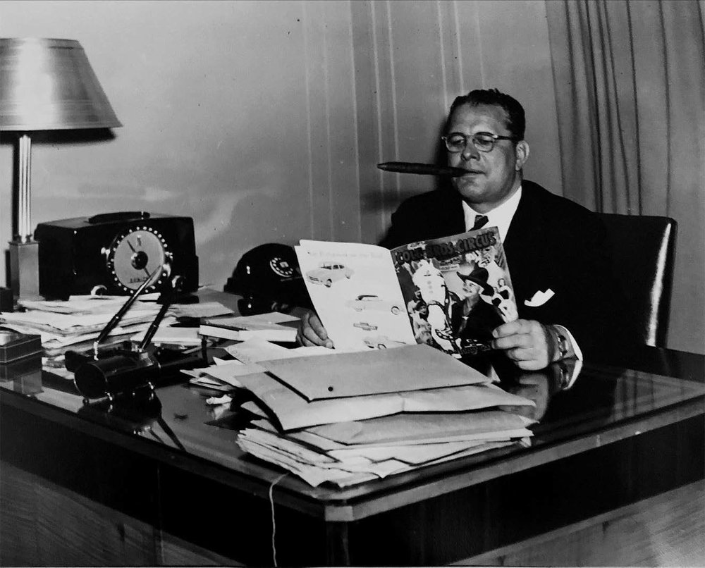 Arthur reading the program for his rodeo show featuring film star Hopalong Cassidy.