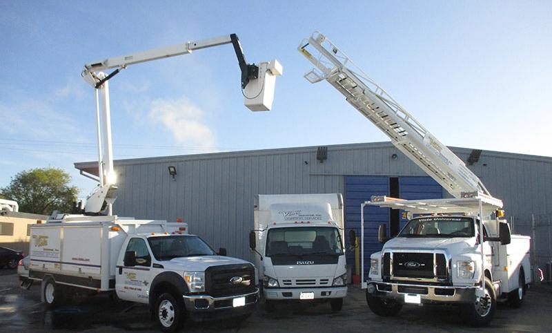 web-pic-34-vehicles-raised-buck-truck-ladder-truck-with-box-van.jpg