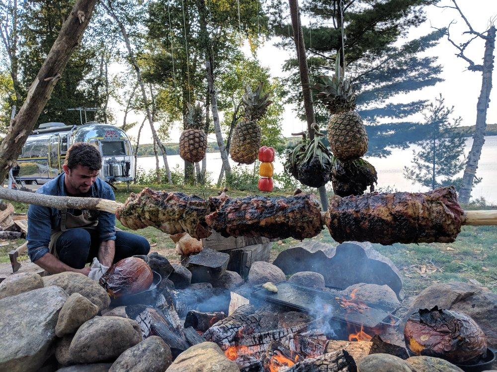 Chef Luca Ballard Cooking Dinner Over An Open Fire