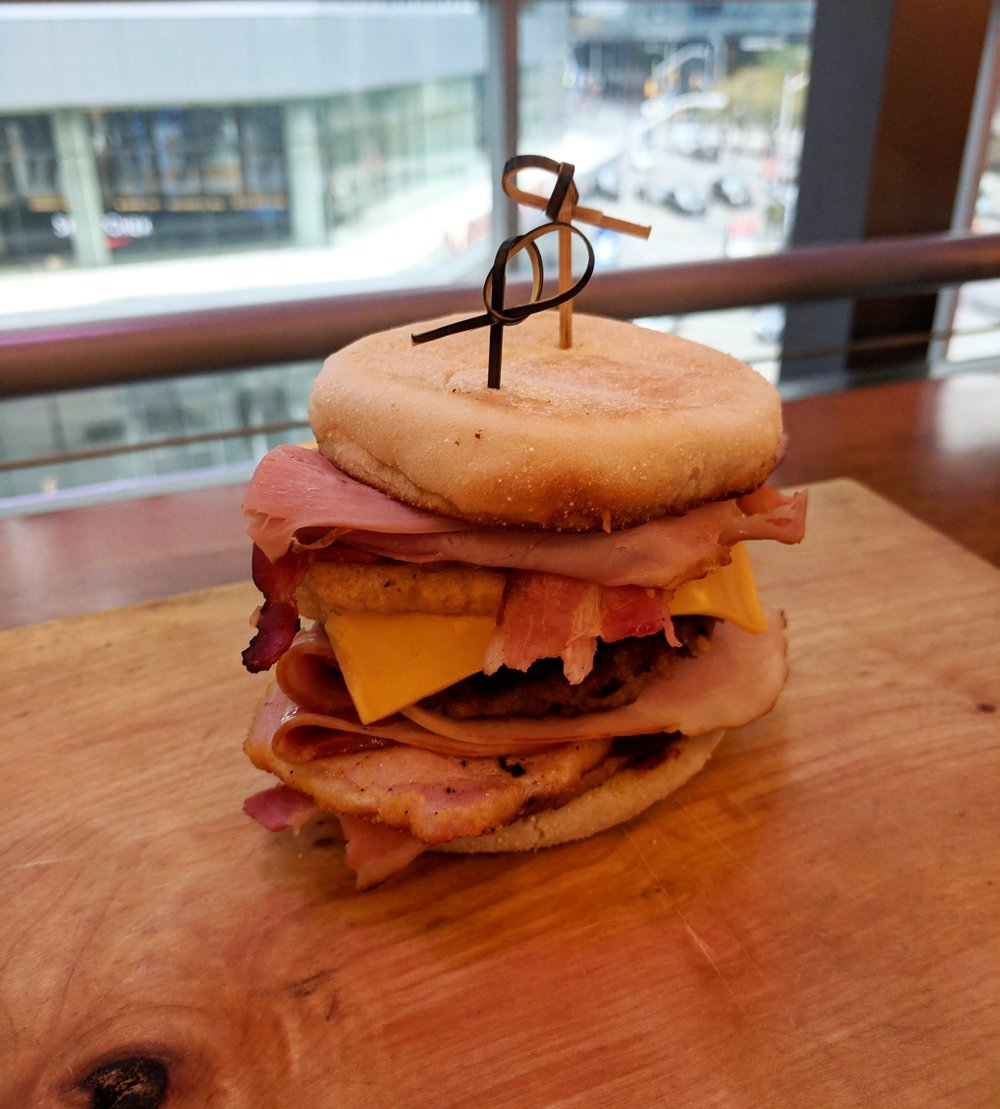 Hogger Sandwich from Food Junction- Triple Decker Peameal Bacon Sandwich with Sausage, Bacon, Cheddar on English Muffin