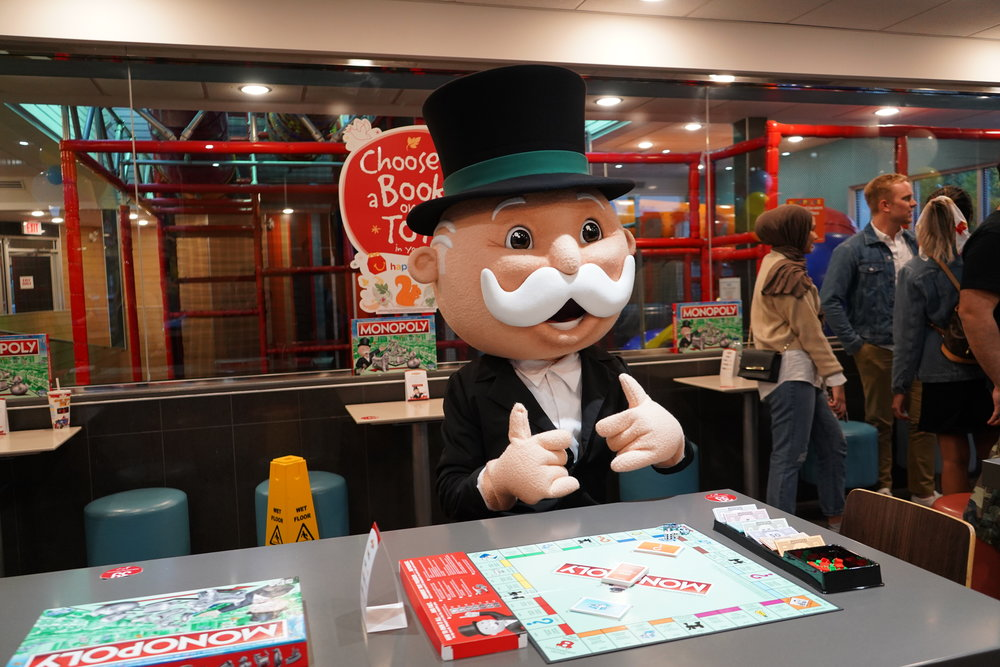 Giant Monopoly Man Taking On Challengers