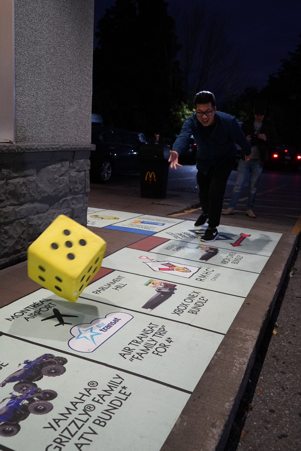Rolling Dice on a Life Size Monopoly Board