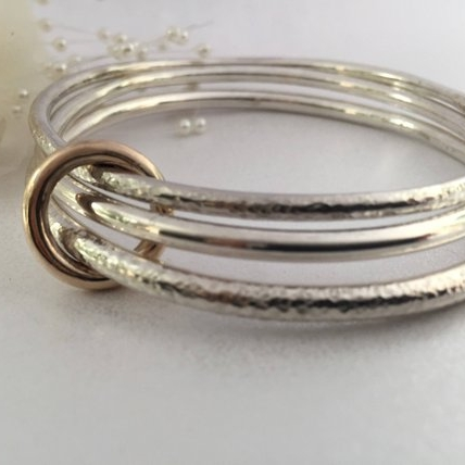 9f3ac3880a3 Set of Three Sterling Silver Bangles Held with a 9c Gold Ring — Jane ...