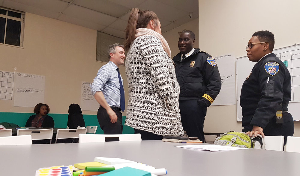 """Major Brian Hance from BPD Recruitment and Captain Mo Brown at a """"Best in Blue"""" workshop at No Boundaries Coalition"""