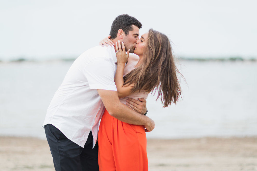 kennedy jarrett engagement proposal kiss on lake beach
