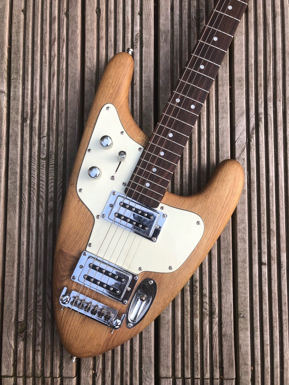 """The first Maybury Guitar - This is the first guitar that was made for my son, """"The Maybury Arrow"""".It has a solid body made from a reclaimed oak worktop, a 25.5"""" scale length, 59 Alnico V Humbuckers, a bolt on neck and a wrap around bridge.Even though it is full scale, it is considerably shorter than most modern electrics making it a very portable guitar.To this day it's still my son's go to guitar, with a uniquely bright but full tone from the oak and Alnico Vs"""