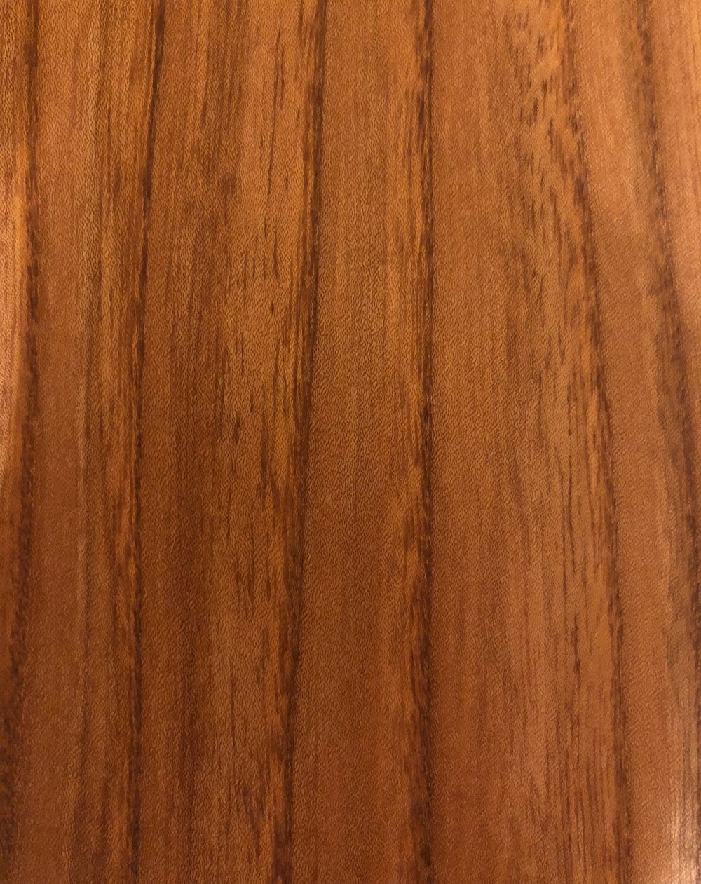 Elm - Ulmus Americana - Elm is a mid brown coloured hardwood with a tight interlocking grain with patterned ridges.Not traditionally used, however it is one of our favourite woods to work with. It has good tone with great looks and looks incredible when made up into a guitar body.It has a warm tone with good sustain.