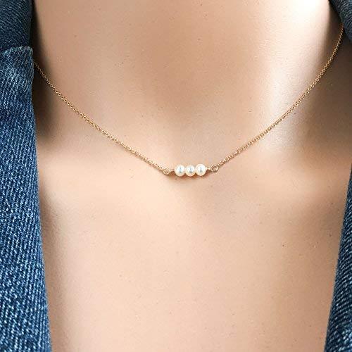 A triple freshwater dainty pearl choker. Find it  here .