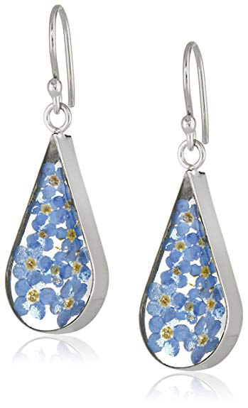 Sterling silver with pressed flowers. Find them  here .