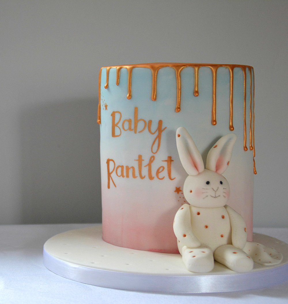 Bunny rabbit baby shower cake with gold drip