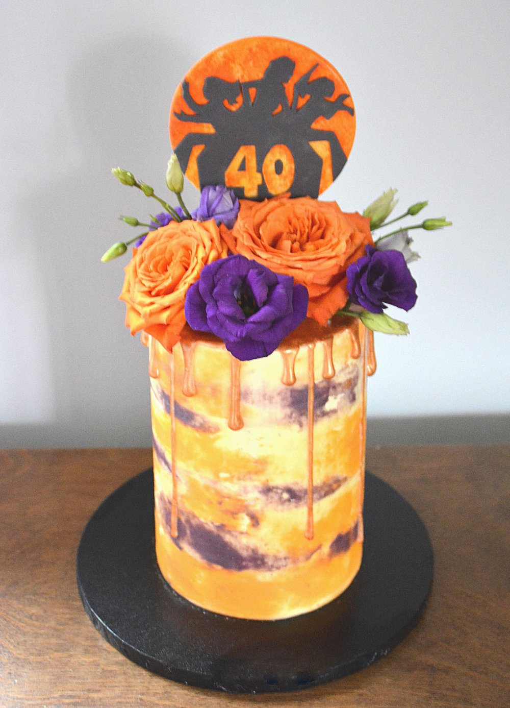 Orange and purple buttercream watercolour Charlie's Angels birthday cake