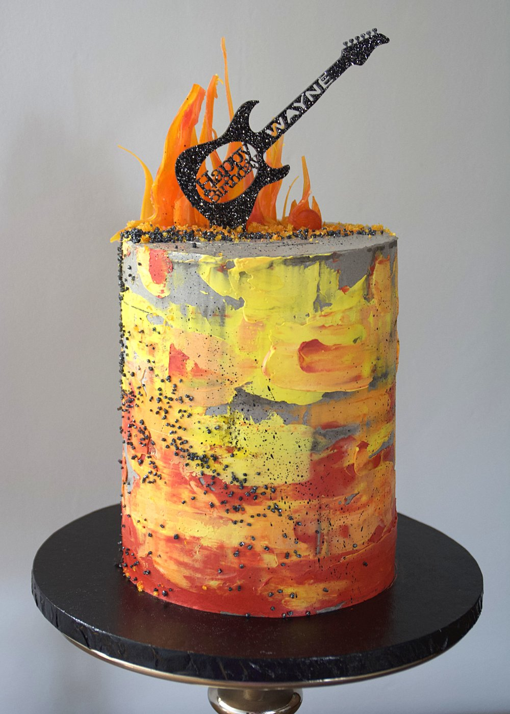 Fire and guitar themed birthday cake