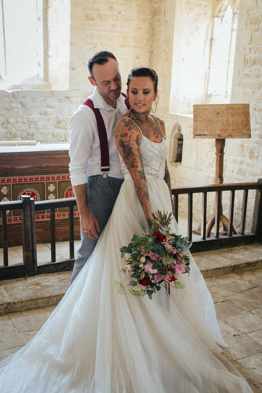 Rock and roll bride and groom in church