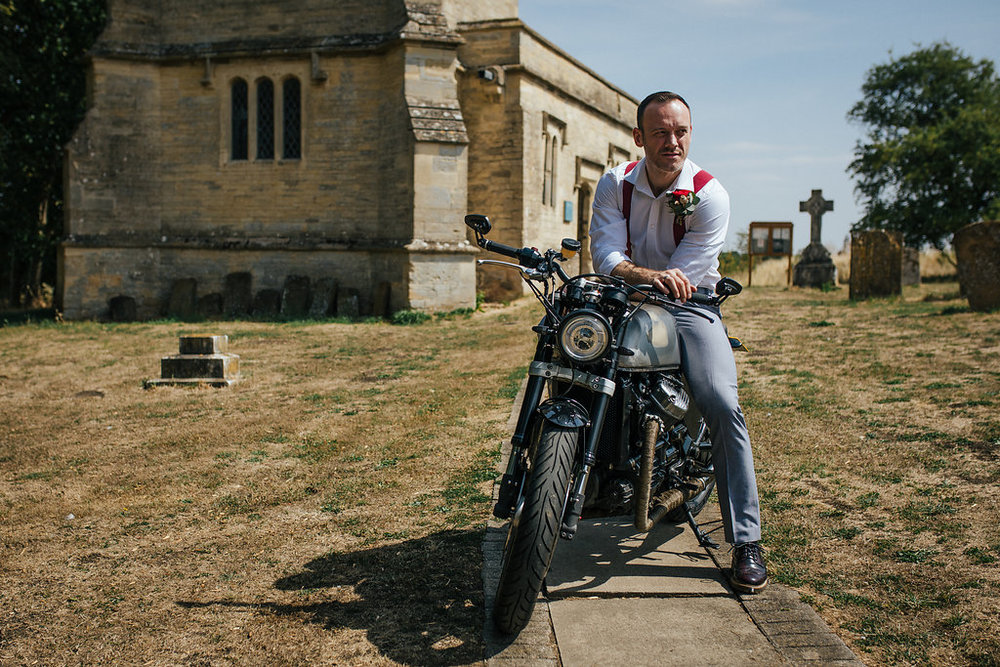 Groom on vintage motorbike