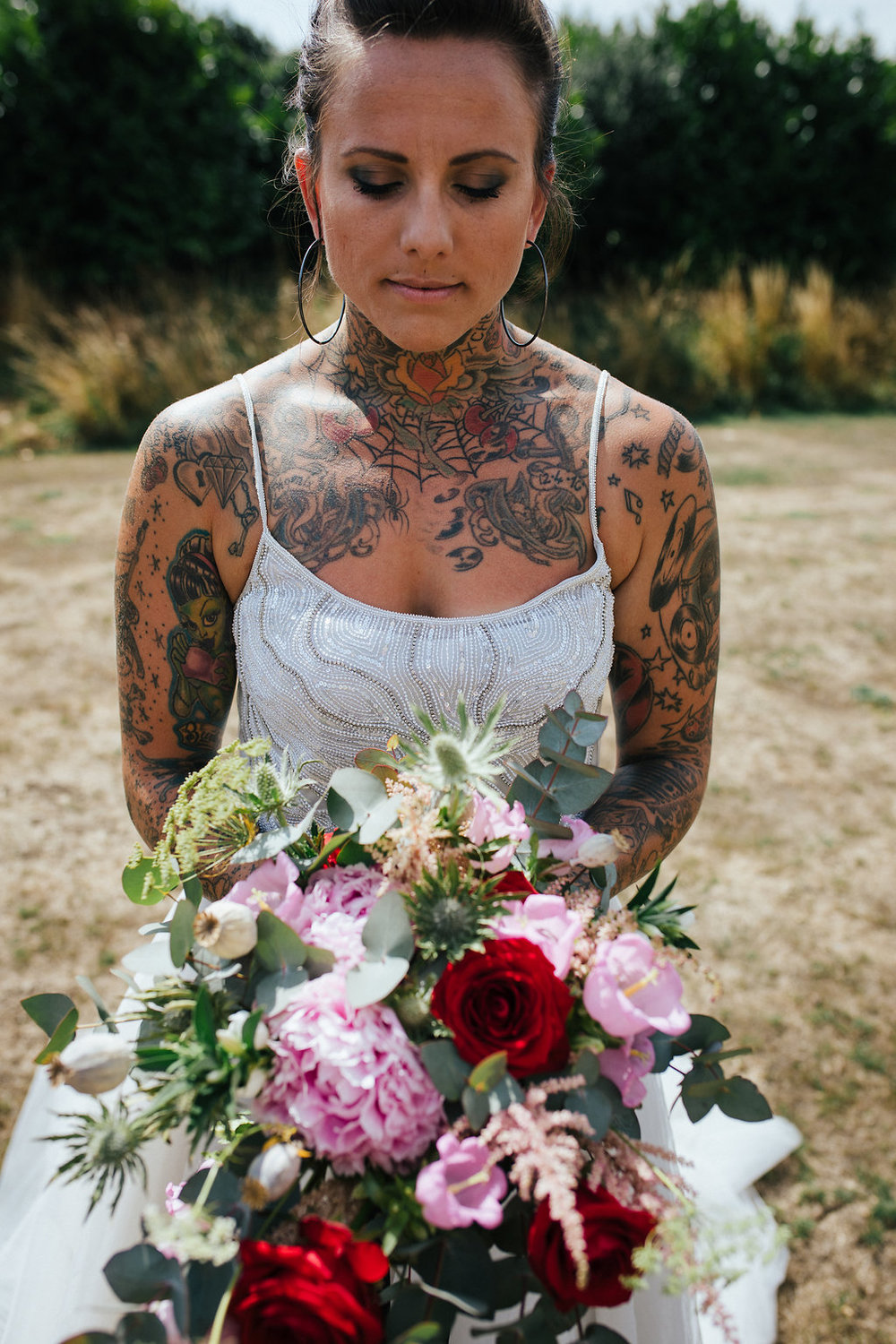 Tattooed bride with wedding bouquet