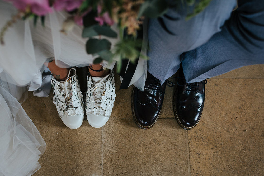 Tattooed bride and groom wedding shoes
