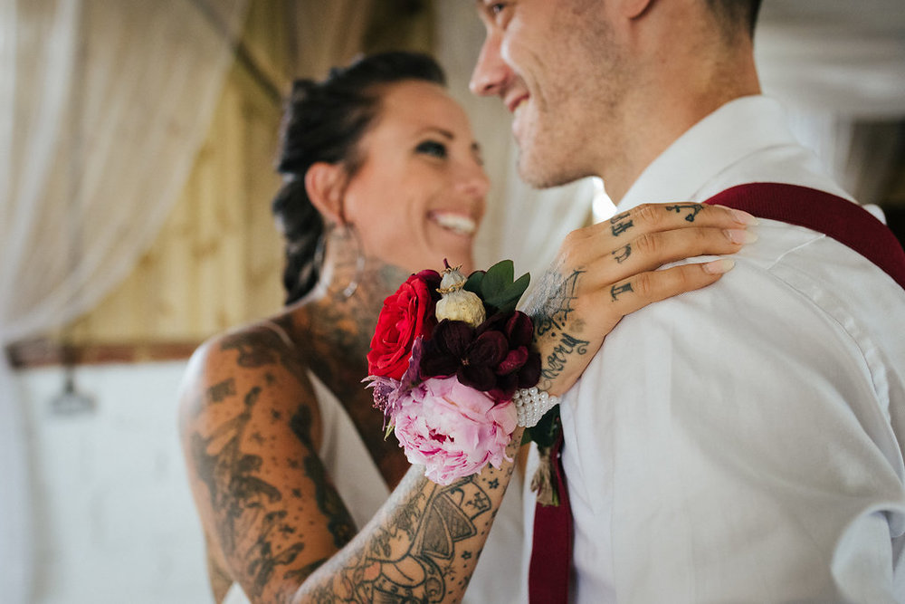 Tattooed bride and groom first dance