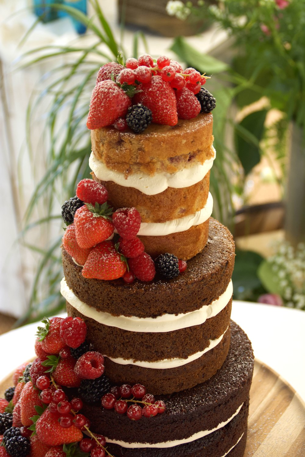 Naked_wedding_cake_with_fruit_cascade.jpg