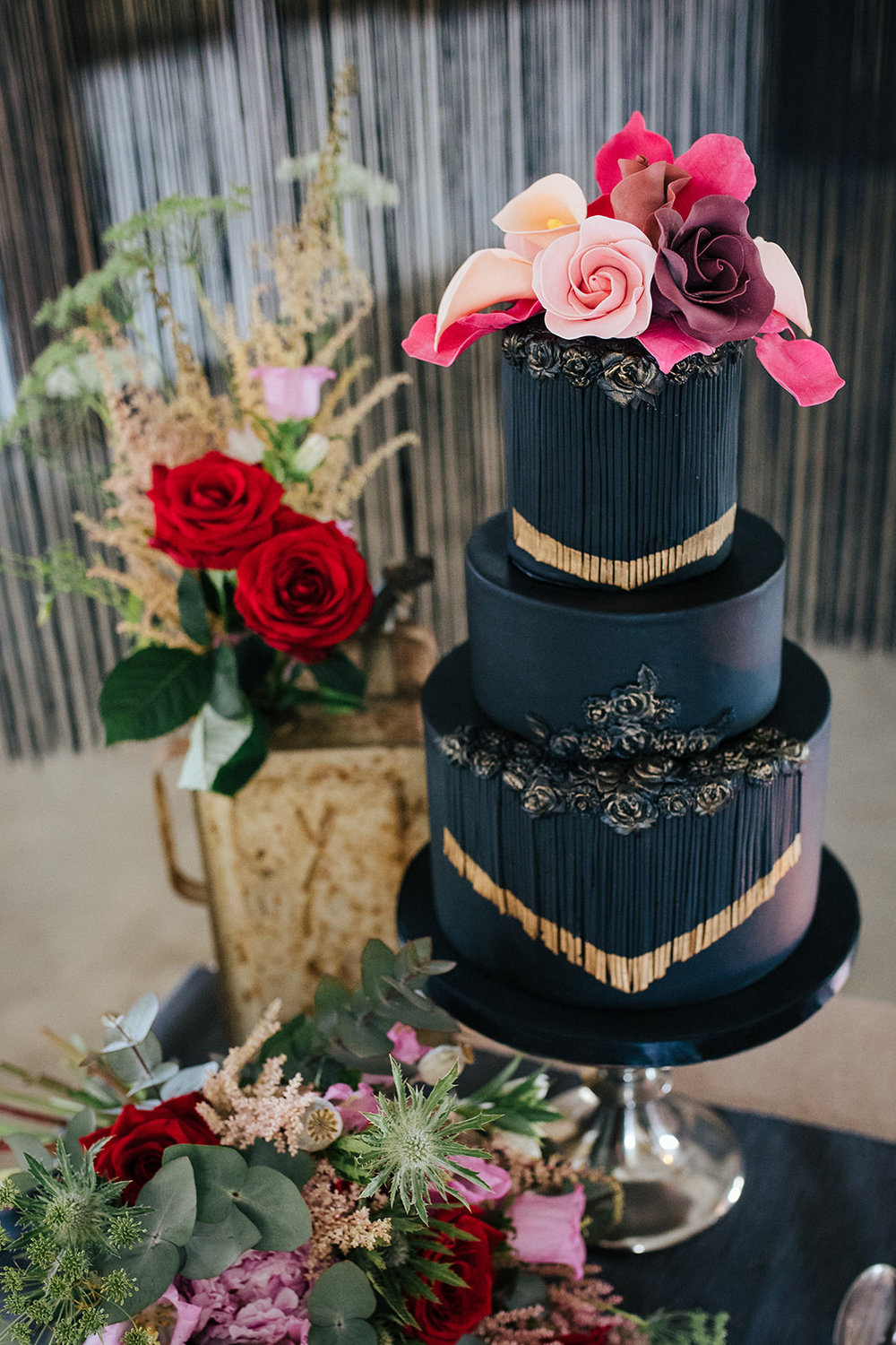 Black and gold tasselled wedding cake