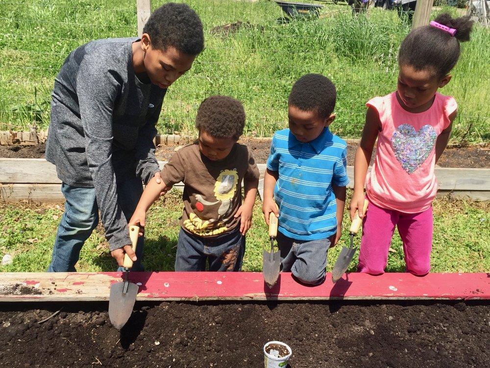muhammad-family-gardening.jpg