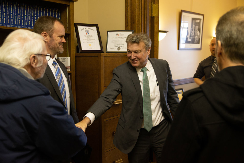 Representative Kitchens greets Hoyt Purinton, Lee Engstrom, Orion Mann and Robert Cornell