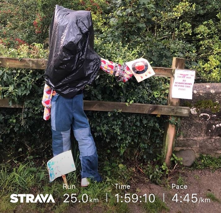 Scarecrow with a bin bag covering him head and details of my run - 25km in 2 hours - for JamesRunsFar.jpg