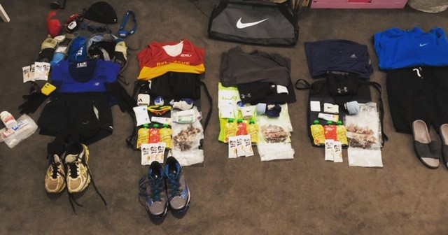 The kit and nutrition needed for the Autumn 100 mile race was extensive! The piles from left to right are; my starting kit, drop bag 1, drop bag 2, drop bag 3 and then kit for after the race (including flip flops).  The  pre-race checklist  that I used helped me feel confident in my organisation and preparation.  I'm  giving it away FREE  so that you can use it for your own races.  Simply  send me an email to James@JamesRunsFar.com  to get it