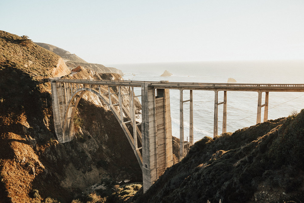 The Bixby Creek Bridge along the coast is one of the most photographed bridges in California for all the obvious reasons - graceful architecture + stunning views.