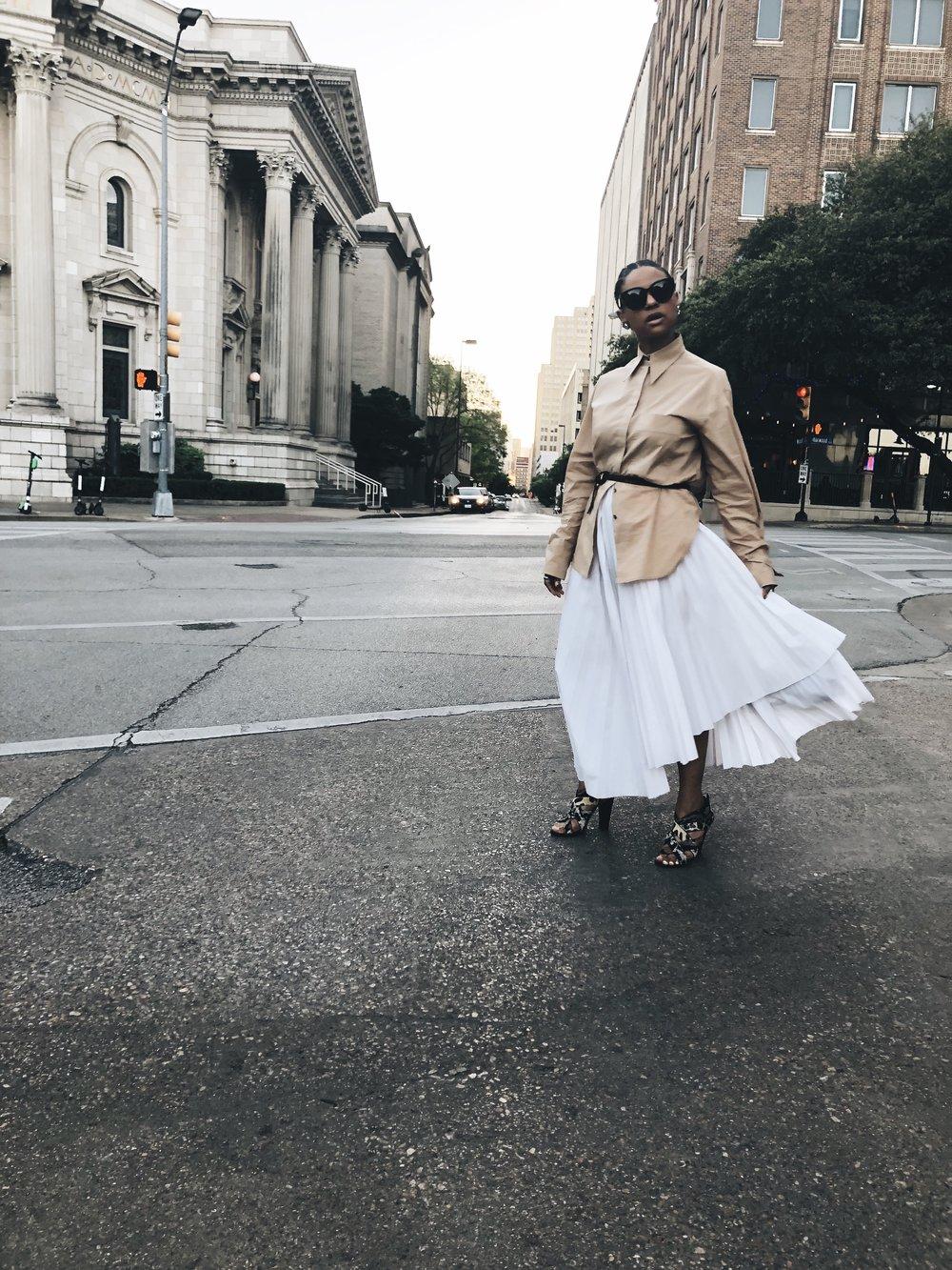 Rejina Pyo Blouse ( similar ). A.W.A.K.E Skirt ( similar ).  J Crew Leopard Belt . Giuseppe Zanotti Sandals ( similar ). Vintage Bag and Earrings.