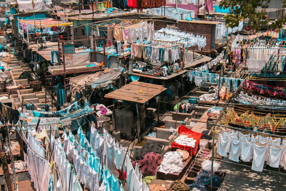 ¿Interesado en viajar a la India? Aquí la guía completa que necesitas saber: vuelos, vestimienta, lugares turísticos, costo, transporte y mucho más.viaje-india-travel-guia-53-Dhobi-Ghat-lavanderia-mumbai