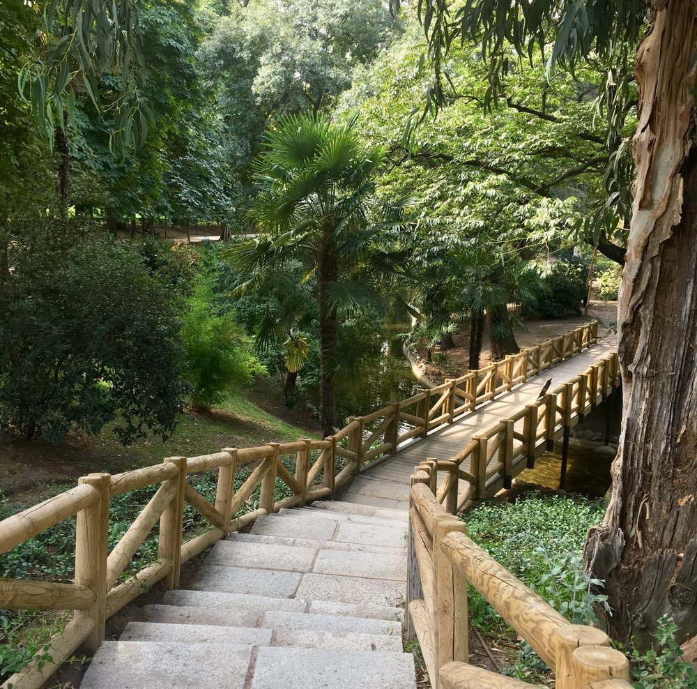 A small bridge located in Parque del Retiro, one of the many large parks in Madrid.