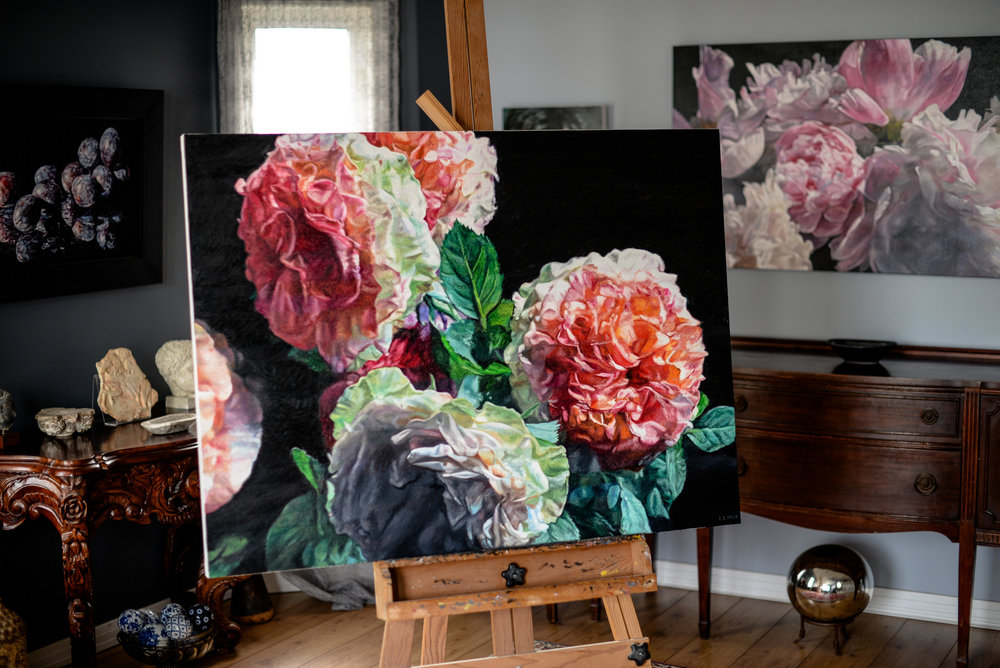 rose painting on easel