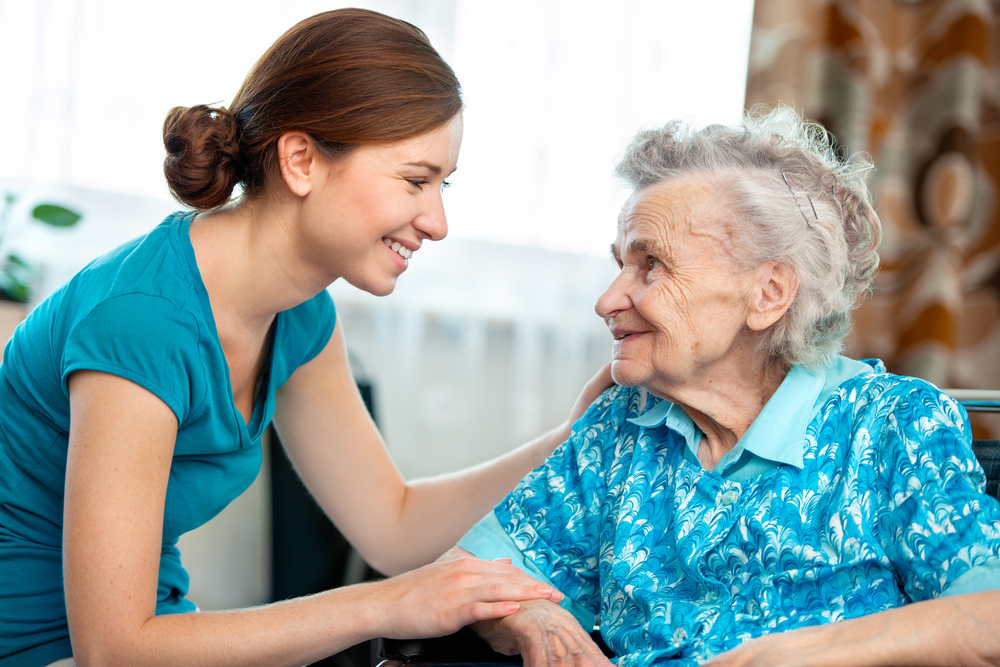 A senior woman with her caregiver