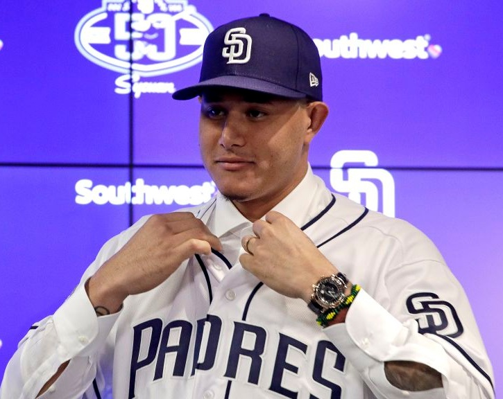 Manny Machado donning the San Diego Padres jersey at his free agent signing press conference.