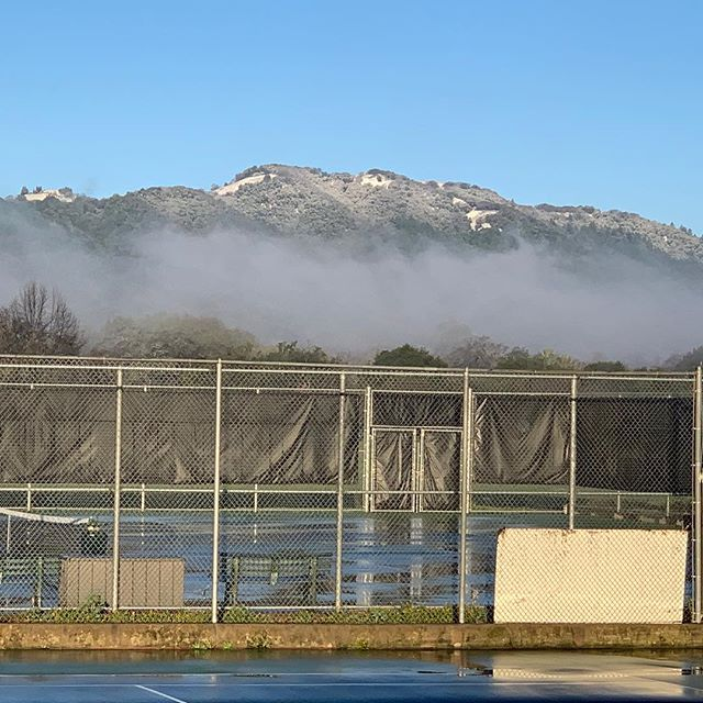 Only in Sonoma, play tennis next to snow capped hills. What a week of weather