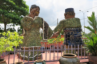 A pair of traditional Malay dancers marks the entrance
