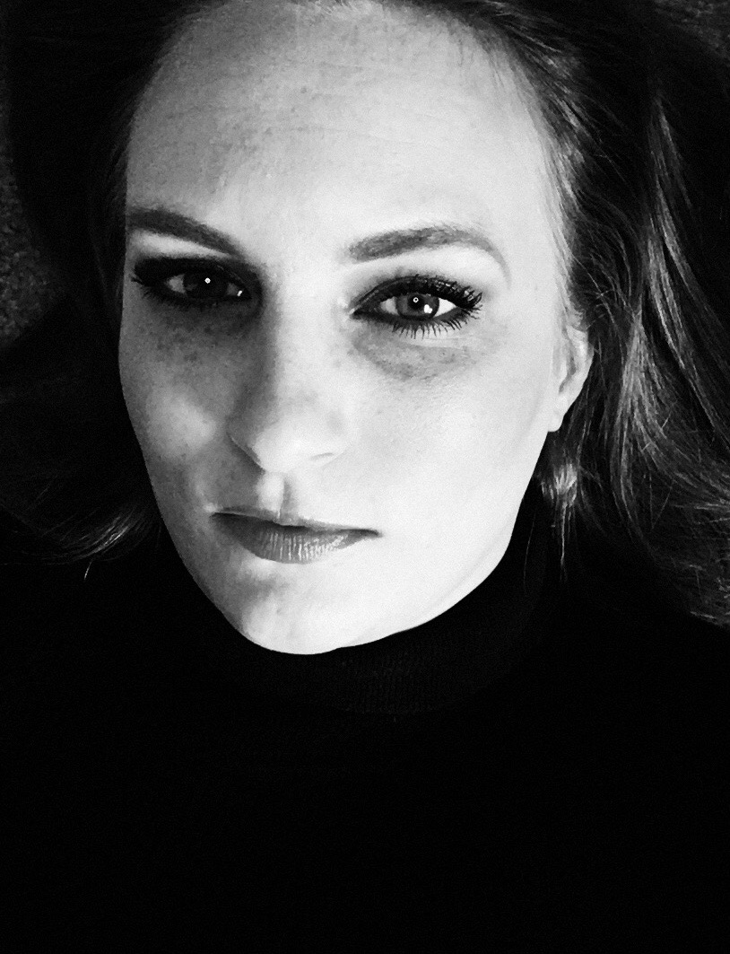 A. N. Gibson pictured in a black turtleneck to give the impression that she is a thoughtful, serious author. Totally works doesn't it?!