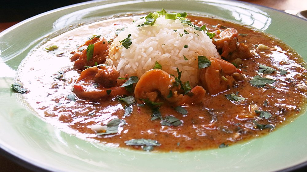 Shrimp / Crawfish Etouffee - Succulent Shellfish smothered down in a roux and tomato based sauce served with rice.