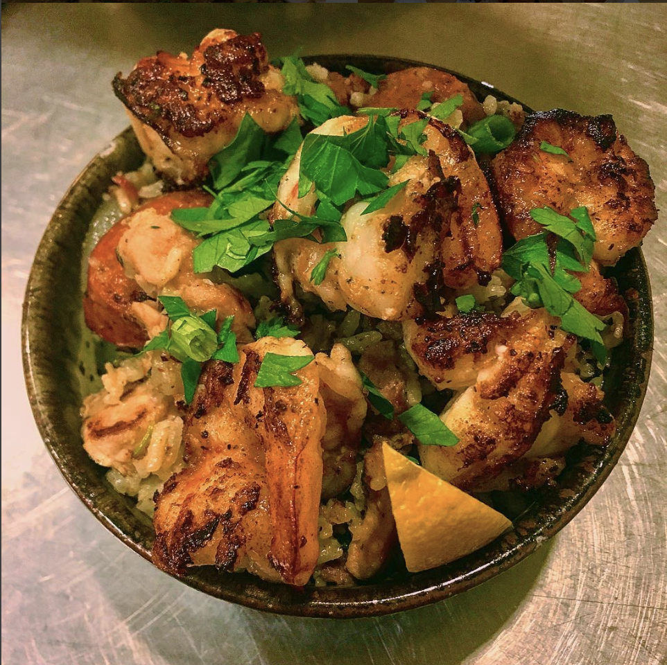 Meme's Rice - This signature Creole rice is a garlic and herb based jambalaya, with dried shrimp in the breakdown, which exudes a distinctive seafood flavor and it also includes chicken thigh meat, prawns, and a melody of sausages.