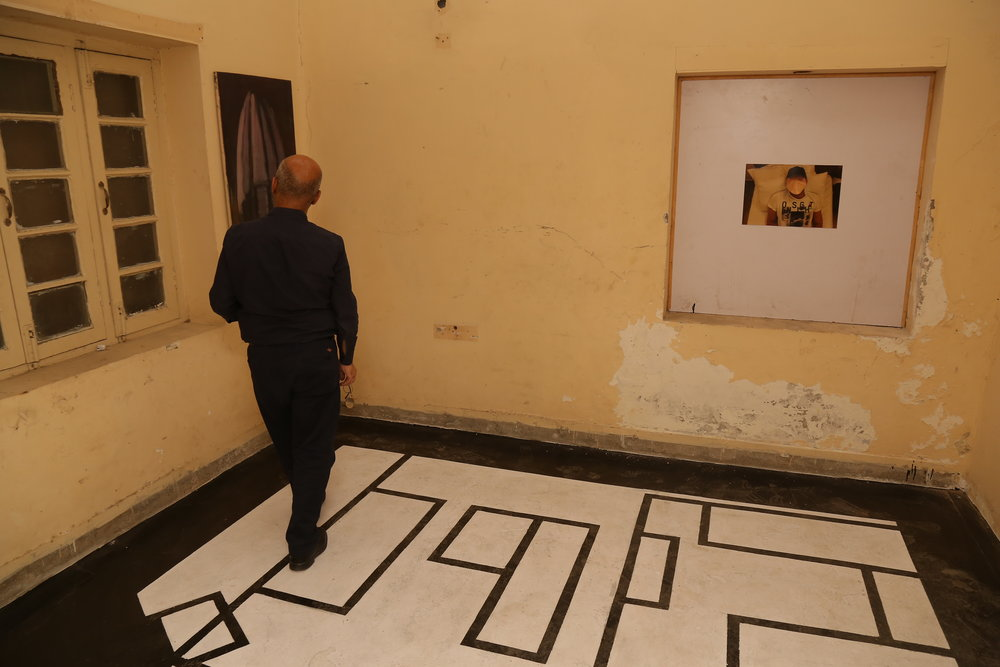 Hide & Seek II, 2018, site-specific installation with a digital photograph, a painting (2009), enamel paint on floor and audio, dimensions variable