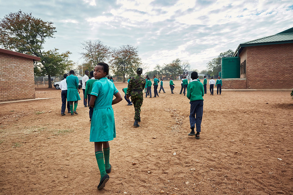 Black Mamba Nkateko Mzimba leaves the classroom to show students how to properly stand at attention, Foskor Primary School, South Arica, 2017.